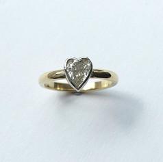 Heart shaped diamond set into 18ct gold