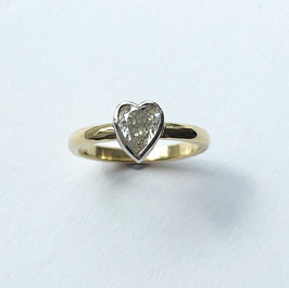 Heart shaped diamond set into 18ct gold