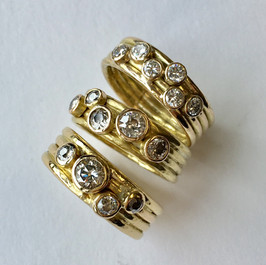 Three rings all in a 4-band style with diamonds.  All these rings were made from customers old gold and diamonds, a great way to use mis-matched stones.