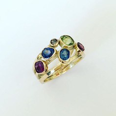 Re-working of a mixture of stones set into 18ct gold