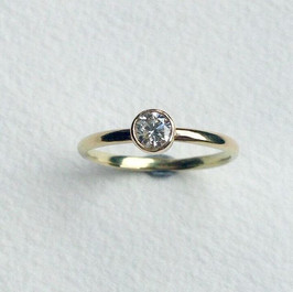22ct Gold and diamond solitaire bezel set ring
