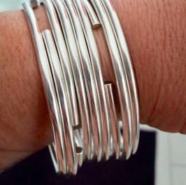 9x silver cuff bangles.