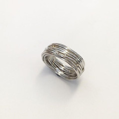 Birds nest ring in sterling silver with tiny gold balls as decoration.