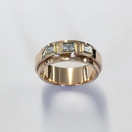 Princess cut diamonds set into a double banded 9ct gold ring
