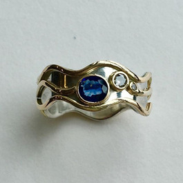 Ceylon sapphire and diamond wave ring, silver with 9ct gold accents