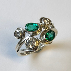 Emeralds and diamonds set in silver