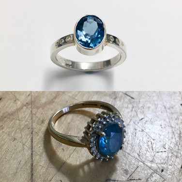 Topaz reset into a silver ring with small flush set diamonds onto shoulders.