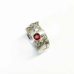 Scrap ring made with silver base, gold accents on top.