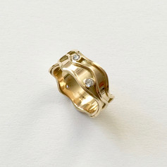 18ct gold wave ring set with 4 diamonds, customer supplied gold to melt down and diamonds.