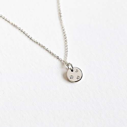 December 2020 - sterling silver and diamond disc pendant