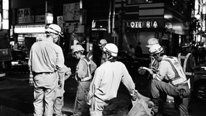 """Tokyo, Japan  <Workers of the World> The people we look to to prop up any given society are the very ones that we rarely even see.       """"No society has any right to forget its workers, because they are the real heroes of the society.""""                                           - Mehmet Murat Ildan"""
