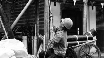 """Shanghai, China  <Workers of the World> The people we look to to prop up any given society are the very ones that we rarely even see.       """"No society has any right to forget its workers, because they are the real heroes of the society.""""                                           - Mehmet Murat Ildan"""