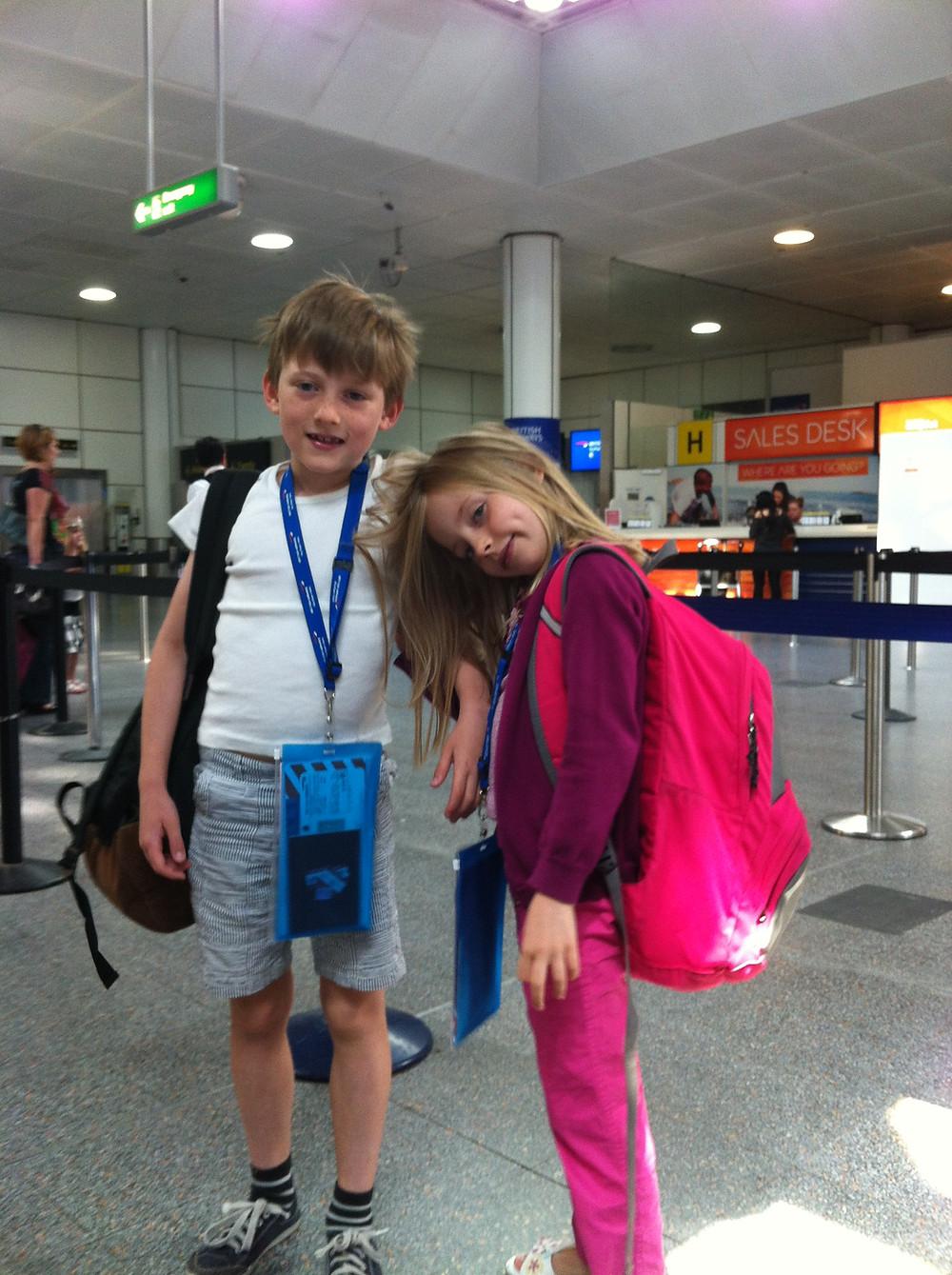 Young children prepare for a flight.