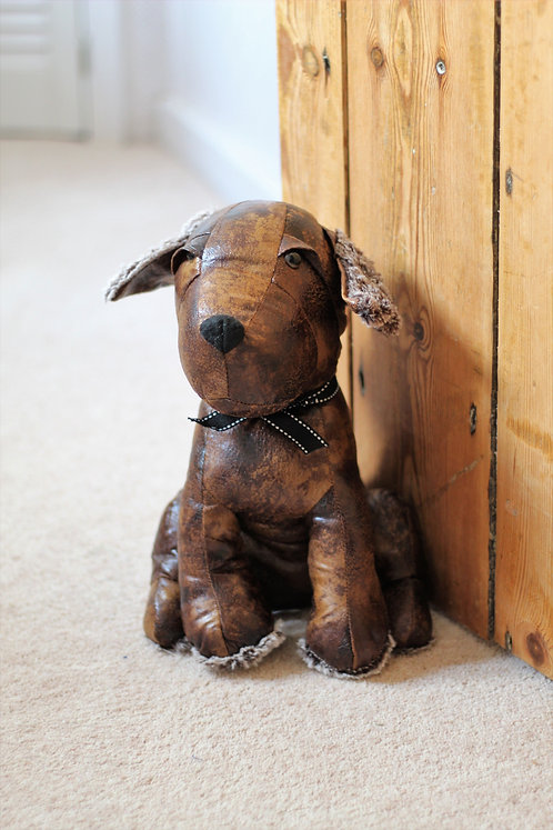 Rustic dog doorstop, made from distressed leather