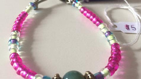 Beaded Bracelet with Purple Tassel