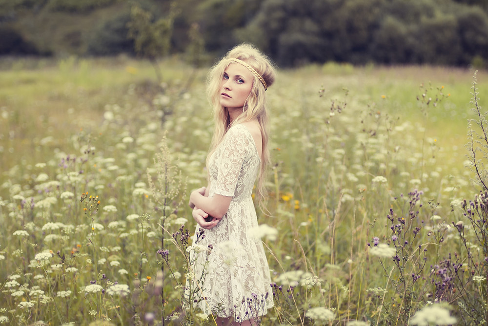 bohemian girl in field of flowers