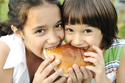 bigstock-Closeup-of-two-children-eating-