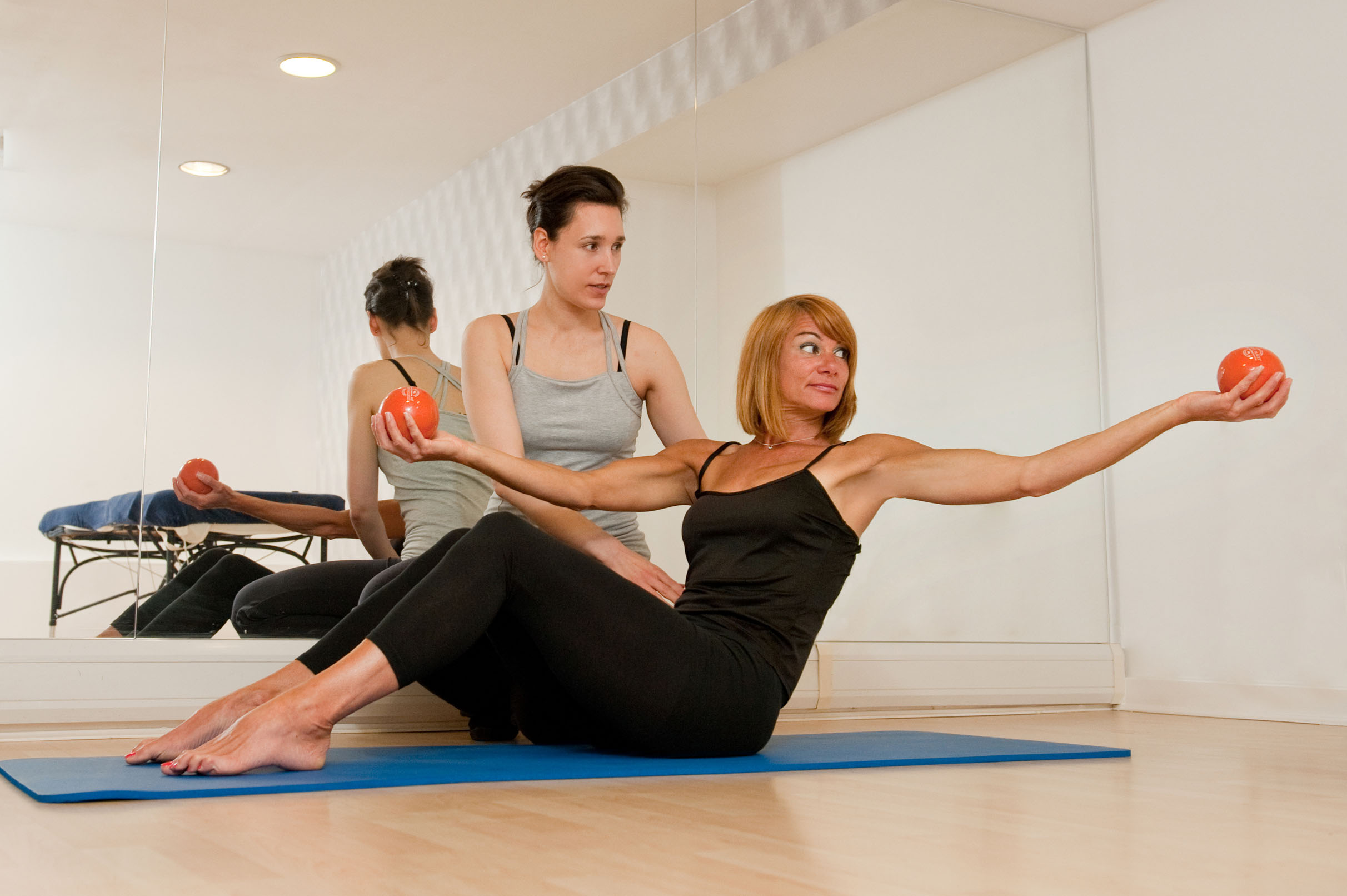 Me supporting my client during a private Pilates session.