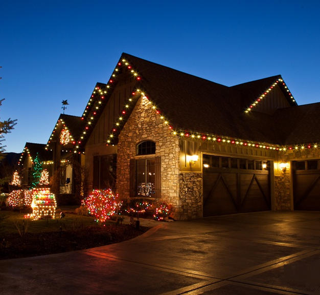 Red and White Roof Line Lighting with Spiral Wrapped tree and Shrub lighting