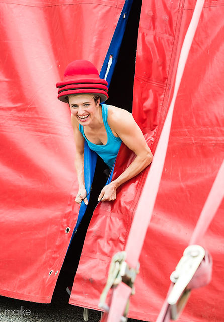 Amanda Crockett peaking out from Circus Flora's red big top in St. Louis
