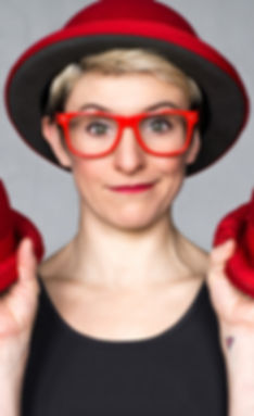 Actor Clown and Professional Juggler Amanda Crockett with her three red hats
