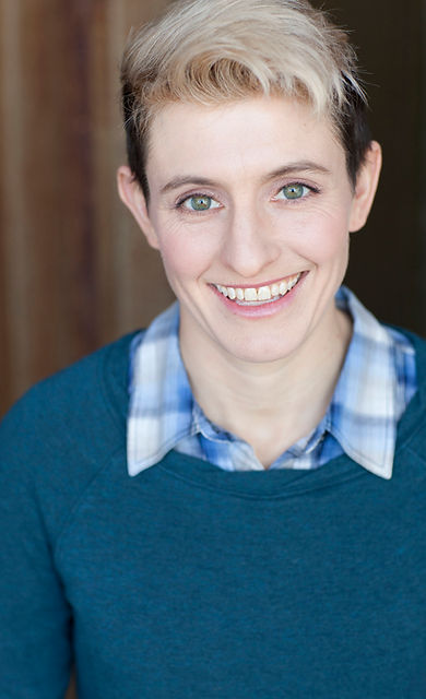 Professional actor clown Amanda Crockett headshot with a blue shirt