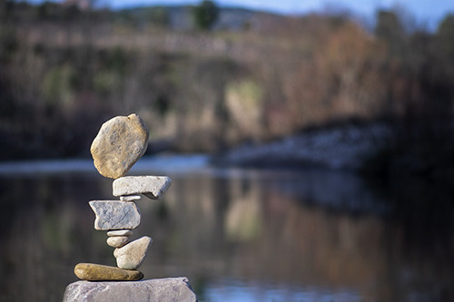 rocks balancing in front of a lake background