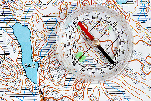 a compass sits on a topographic map