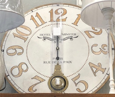 Reloj pendulo tostado