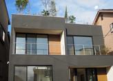 高低差のある敷地をつなげてメゾネット賃貸併用住宅を建設