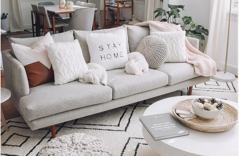 layered throw pillows and blankets