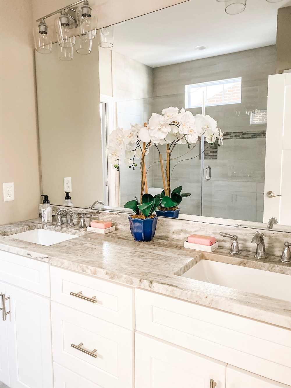 potted faux orchid in bathroom