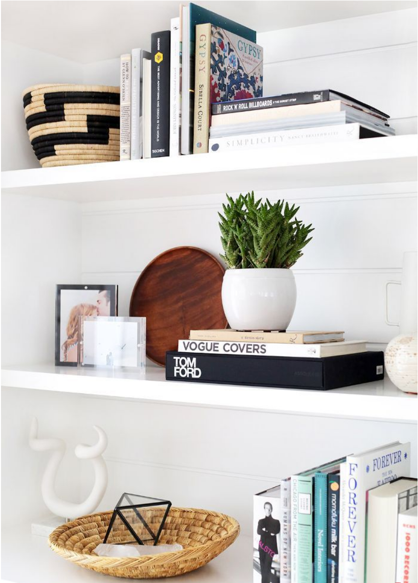 built-in shelves styled with books and accessories