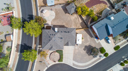 Overhead shots show the yard and driveway