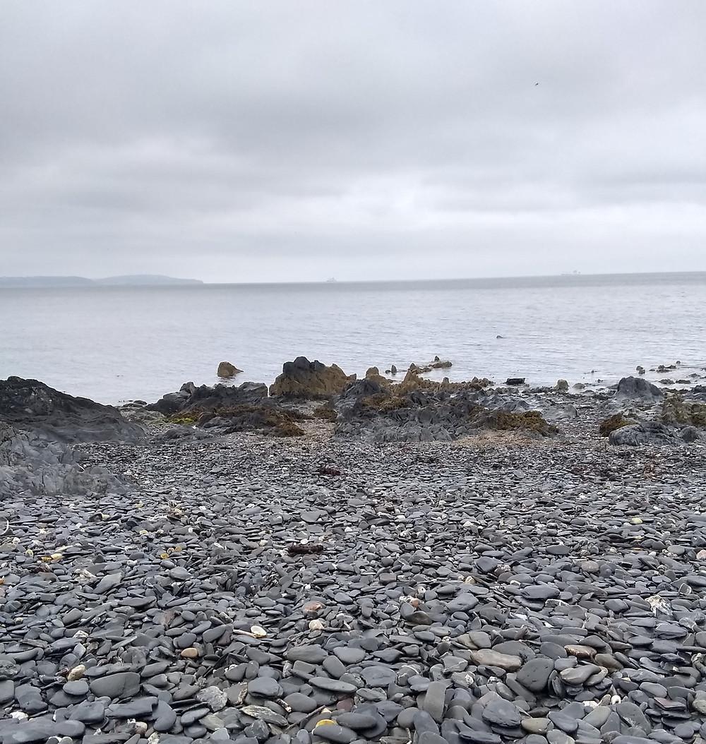 a stony beach and a gray sky