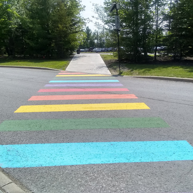 Rainbow crossing to RCMP lot - Michelle