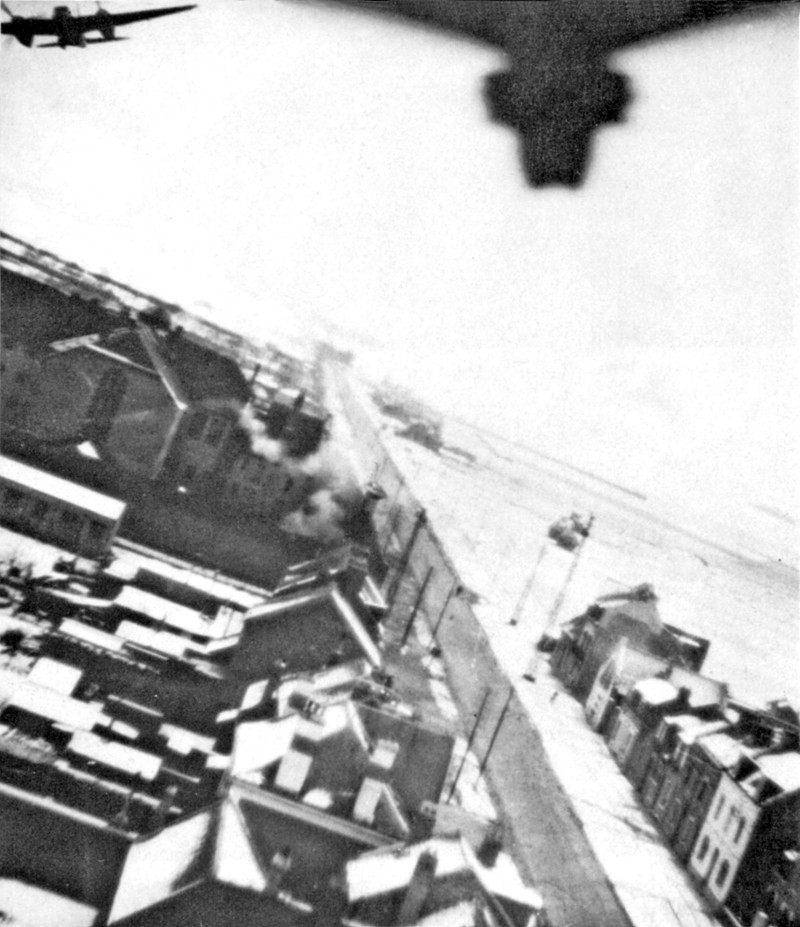 The precision achieved by the Mosquito made it ideally suited for challenging targets such as Ameins Prison, the POW Camp targeted during Operation Jericho. This image, taken from an accompanying reconnaissance aircraft, shows the strike Mosquito with bomb bays upon. [Image Credit: Imperial War Museum]