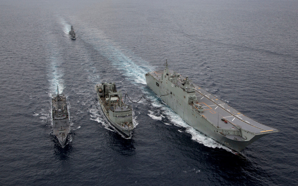 HMAS Success (centre) conducts a replenishment at sea with HMA Ships Adelaide and Melbourne followed by HMAS Toowoomba, during Exercise Indo-Pacific Endeavour 2018. [Image credit: Australian Department of Defence]