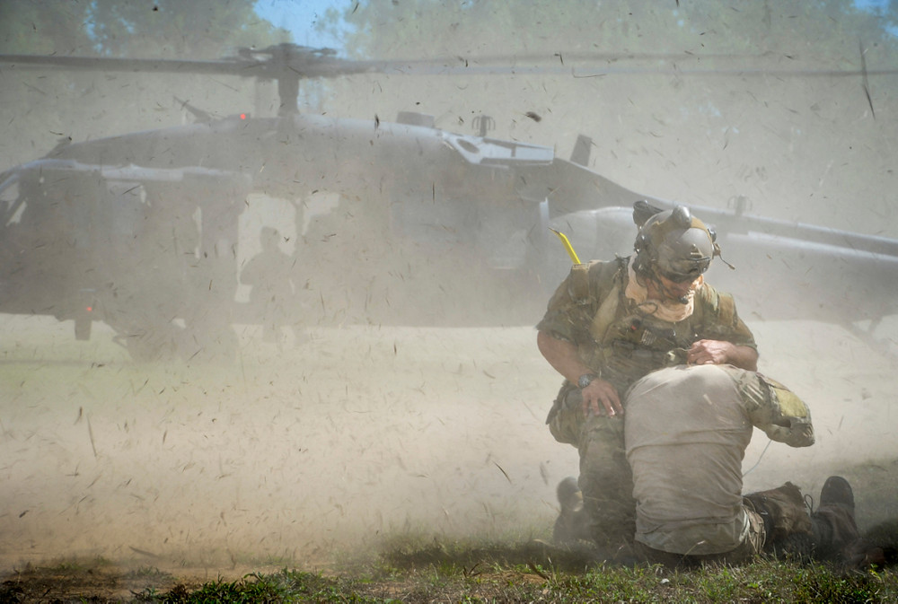 United States Air Force Pararescuemen of the 129th Rescue Wing move injured role players to the landing zone for extraction by HH-60 Pave Hawk combat search and rescue helicopter during Exercise Angel Reign 16 CSRA exercise in Townsville. [Image Credit: Department of Defence]