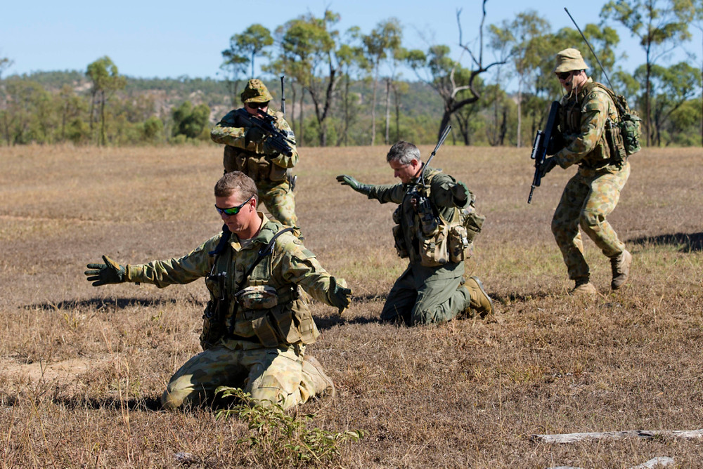 Royal Australian Air Force staff from the Combat Survival Training School demonstrate a combat search and rescue recovery during the Survival, Evasion, Resistance and Escape course at the Townsville Field Training Area. [Image Credit: Department of Defence]