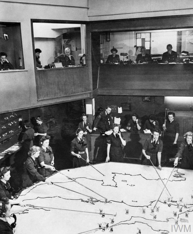 The Operations Room at RAF Fighter Command's No. 10 Group Headquarters, Rudloe Manor (RAF Box), Wiltshire, 1943. © IWM (CH 11887)