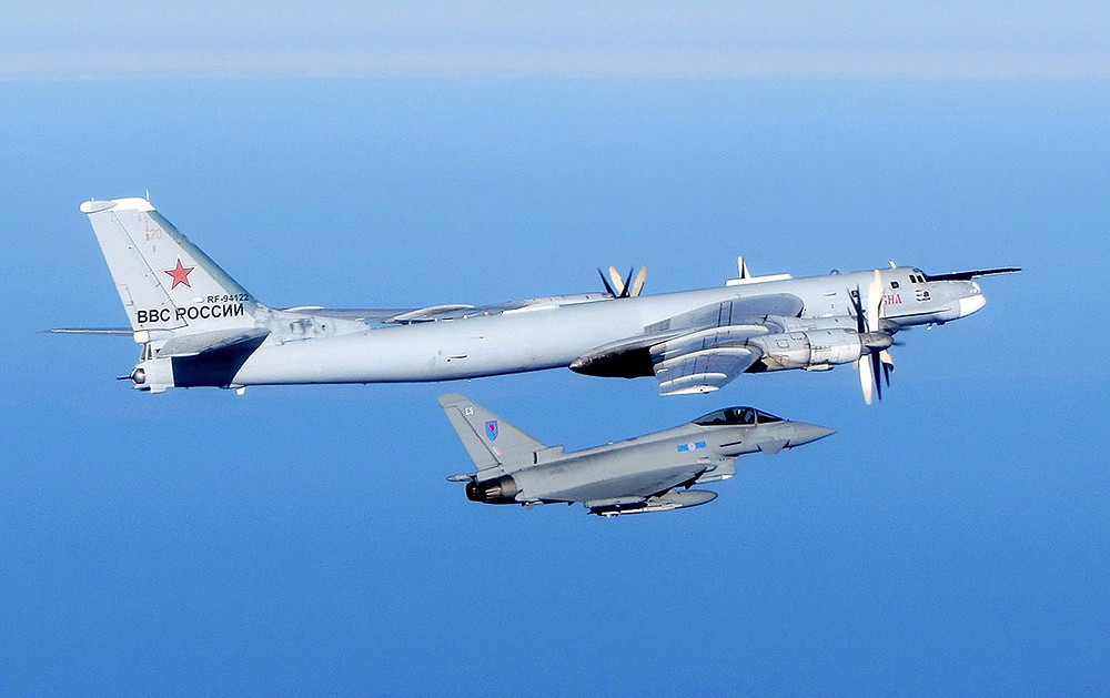 A Russian Bear aircraft is escorted by a Royal Air Force Quick Reaction Alert (QRA) Typhoon during an intercept in September 2014. [Image Credit: Crown copyright 2014]
