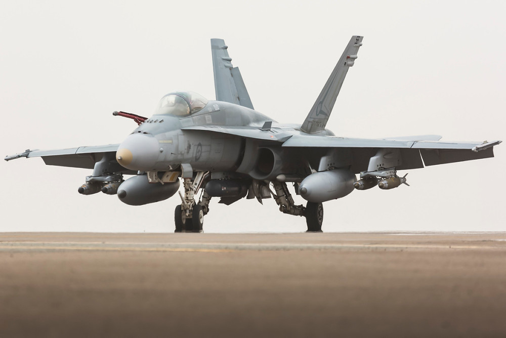 A Royal Australian Air Force F/A-18A Hornet taxies back into the main air operating base in the Middle East Region following a mission in support of Operation Okra. [Image Credit: Department of Defence]