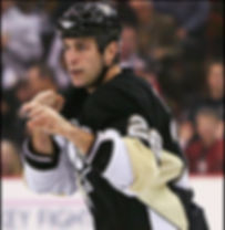 """2007-08 NHL Season: (74) games and 171 penalty minutes (171) with Calgary; 2008-09 NHL Stanley Cup Champion with Pittsburg Penguins: 2008-09 NHL Season: voted 'Player's Player'.  Eric Godard is a Canadian retired professional ice hockey right winger and three-time Stanley Cup winner, who played 12 seasons in the National Hockey League with the New York Islanders, Calgary Flames and the Pittsburgh Penguins. Godard was known as an enforcer for his physical style of play and regularly dropping the gloves. His nickname is """"The Hand of God"""". Godard played 335 games in the NHL with 119 fights; racking up over 800 pims plus more than a thousand more in junior and minor pro.  Godard made his NHL debut with the Islanders on October 17, 2002, against thePhiladelphia Flyers. In his next game on December 6, Godard recorded his first career fight againstTie Domi of theToronto Maple Leafs. In the2005–06 NHL seasonGodard set career highs in 57 games, and also reached 100 penalty minutes for the first time (finishing with 115). Godard also scored his first career goal and finished the year with four points. Godard again set career highs in 74 games 171 and penalty minutes with Calgary in the2007-08 NHL season; during which he also played in his first playoff game, dressing in five in the Flames' first round series with theSan Jose Sharks.  During the 2008-09 season, Godard won the NHL Stanley Cup Champion with the Pittsburg Penguins. That same year, Godard was voted 'Player's Player' by his teammates. On November 2, 2012, Godard officially announced his retirement."""