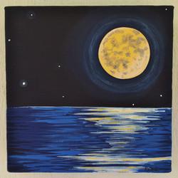 full moon medicine over sea
