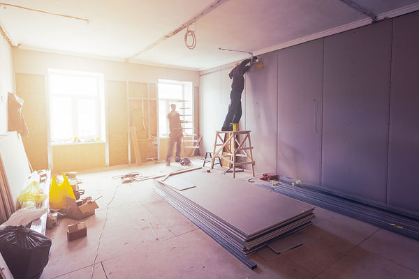 Workers are installing plasterboard (dry