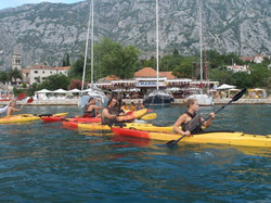 Group kayaking in Kotor, Montenegro