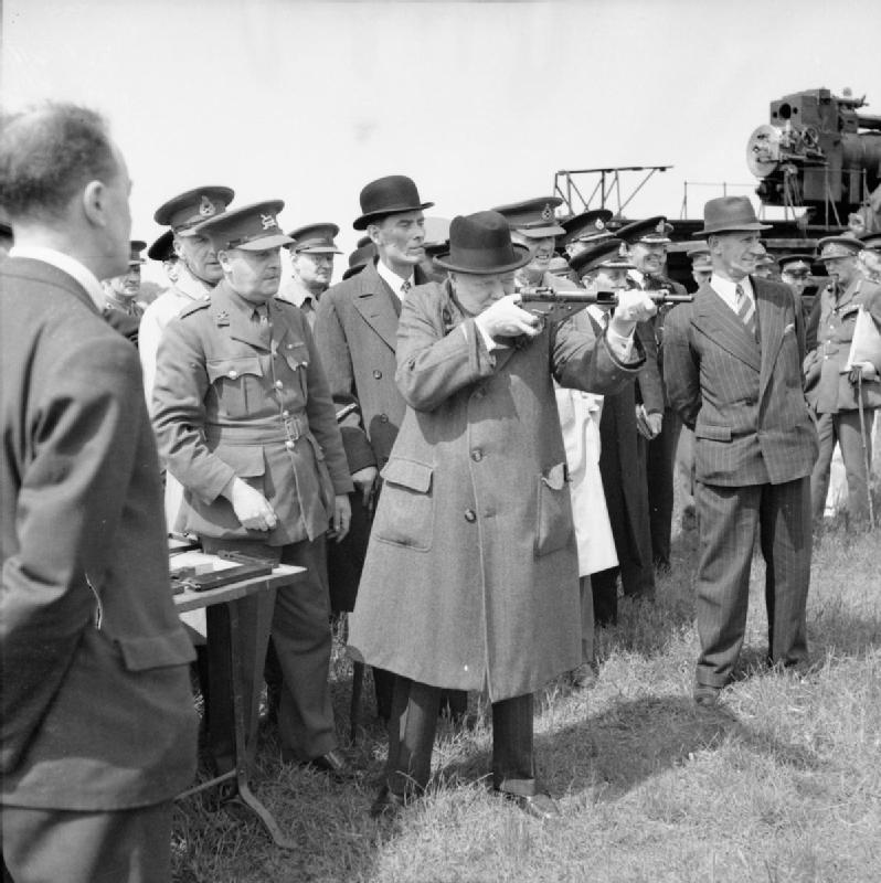 Winston Churchill with a Sten Mk II in S