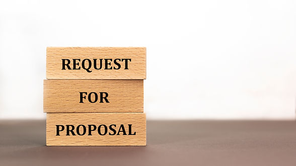 Request for proposal written on wood blo