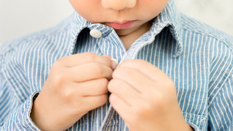 7 Tips for Teaching Kids to Button